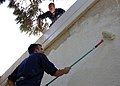US Navy 060904-N-3594V-001 Interior Communications Electrician 3rd Class Steve Chisholm (bottom) and Electronics Technician 3rd Class Joshua Miller paint the exterior walls of the Theotokos Foundation in Limassol, Cyprus.jpg
