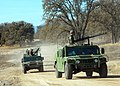 US Navy 061207-N-3560G-007 Members of Naval Mobile Construction Battalion Four (NMCB-4) convoy in High Mobility Multipurpose Wheeled Vehicles (HMMVVs) during field exercise Operation Bearing Duel.jpg