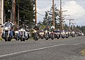 US Navy 070420-N-3321R-004 Whidbey Island Sailors and community motorcyclists ride down the street before gathering together for a final police lead escort through downtown Oak Harbor.jpg