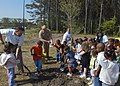 US Navy 070425-N-1082Z-003 Area forester for the Va. Department of Forestry, Jack Kauffman, along with Naval Air station (NAS) Oceana Commanding Officer Capt. Patrick Lorge help children shovel dirt around a tree planted at Oce.jpg
