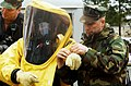US Navy 080130-N-2143T-002 Explosive Ordnance Disposal Technician 1st Class Matthew Harrison, assigned to Mobile Unit (EODMU) 11 based out of Whidbey Island, Wash., helps Chief Explosive Ordnance Disposal Technician Patty Keil.jpg