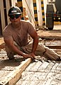 US Navy 080929-N-3560G-286 Steelworker 3rd Class Arnoldo Sotorivas removes excess concrete.jpg