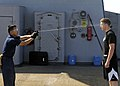 US Navy 090213-N-7280V-009 Storekeeper Seaman Sergio Torres sprays Seaman Chad Tomes with lemon juice to simulate getting spayed with Oleoresin Capsicum.jpg