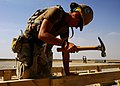 US Navy 090430-N-0981M-041 Builder 3rd Class Amy Higgins, assigned to Naval Mobile Construction Battalion (NMCB) 11 Air Detachment Afghanistan, builds a Southwest Asia hut.jpg