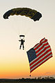 US Navy 090529-N-1928O-152 Chief Petty Officer Justin Gauny, a member of the U.S. Navy demonstration parachute team, the Leap Frogs, descends during an aerial display at the Southern Wisconsin Airfest.jpg