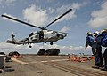 US Navy 100304-N-7088A-131 An SH-60B helicopter prepares to transfer supplies to the Military Sealift Command fleet replenishment oiler USNS Patuxent (T-AO 201).jpg
