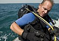 US Navy 100317-N-4776G-002 Chief Explosive Ordinance Disposal Technician Randy Leppell dons his buoyancy compensator before diving in the Arabian Gulf.jpg