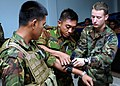 US Navy 100505-N-8377A-039 Quartermaster 2nd Class Caleb Murray works with two members of the Royal Brunei Navy Support Squadron, demonstrating the proper use of a tourniquet.jpg