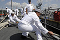 US Navy 100512-N-8335D-157 Sailors heave on mooring lines as the mine countermeasures ship USS Patriot (MCM 7) arrives in Sasebo, Japan at the end of its spring patrol.jpg