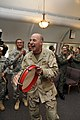 US Navy 101220-N-3887D-106 Rear Adm. Jeffery Harbeson, commanding officer of Joint Task Force Guantanamo, taps a tambourine during a musical perfor.jpg
