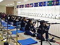 US Navy 110212-N-FO977-327 Navy Junior Reserve Officers Training Corps sporter division cadets line up in the kneeling firing position as they prep.jpg