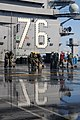 US Navy 110323-N-NB544-186 Sailors scrub the flight deck aboard the aircraft carrier USS Ronald Reagan (CVN 76) following a countermeasure wash dow.jpg