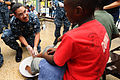 US Navy 110421-F-CF975-233 Capt. Brian Nickerson, mission commander of Continuing Promise 2011, washes the feet of a Harbor View Primary School stu.jpg