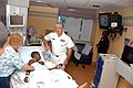 US Navy 110428-N-PS473-024 Vice Adm. Daniel P. Holloway visits with a child at the Joe DiMaggio Children's Hospital in Hollywood, Fla. during Fleet.jpg