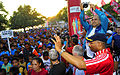 US Navy 110618-N-KB563-263 Dr. Jose Ramos-Horta snaps a photograph of Capt. Jesse A. Wilson t the start of the Marathon for Peace race.jpg