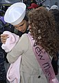 US Navy 111210-N-PI709-136 Personnel Specialist Seaman Nicholas Smith meets his daughter for the first time after returning to Naval Station Norfol.jpg