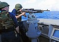 US Navy 111212-N-ZF681-770 Ensign Timothy Eick fires a M-240 machine gun aboard the guided-missile destroyer USS Halsey (DDG 97). Halsey is on a sc.jpg