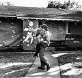 University of Texas at Arlington homecoming; two students dance in yard outside Delta Zeta house (10011004).jpg