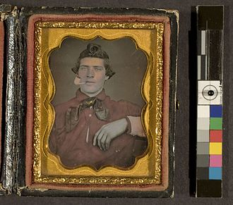 Hand-colouring of photographs - A framed hand-coloured daguerreotype (c. 1850) from the George Eastman House in Rochester, NY.