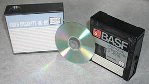 Video Cassette Recording - VCR-format video cassettes, with CD shown for scale.