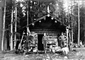 Victor Denny, William Denny and Dan Hines outside Esther Mine headquarters cabin at head of Keechelus Lake, 1901 (LL 1294).jpg