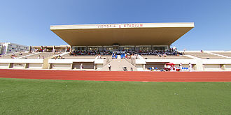 Sport in Gibraltar - The western stands at the Victoria Stadium in Gibraltar.