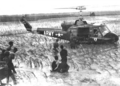 Viet Cong prisoners at a rice field near Huey helicopter.png