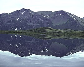 View of the Ahklun Mountains reflected in mirror-smooth Upper Togiak Lake.jpg
