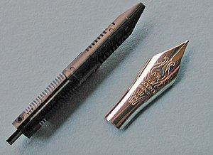 Nib (pen) - Detail of a Visconti stainless steel fountain pen nib and feed