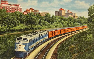 City of St. Louis (train) - Postcard depiction of the train headed by a Wabash diesel.  The Union Pacific shield and the Wabash flag are seen on the locomotive's nose.