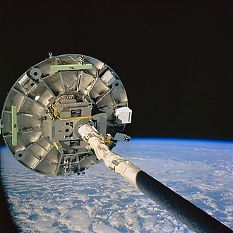 Space manufacturing - The Wake Shield Facility is deployed by the Space Shuttle's robotic arm. NASA image
