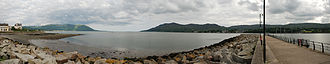 Warrenpoint - Standing at warrenpoint pier, we are looking at Northern Ireland to the left and Republic of Ireland to the right of the Carlingford Lough's estuary