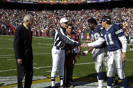 Bledsoe with Greg Ellis in a 2006 game. Washington Redskins and the Dallas Cowboys coin toss 2006.jpg