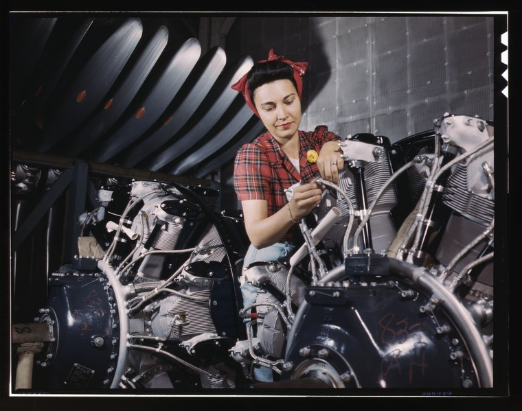 Woman Working on Airplane motor 1a35287u