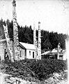 Women in front of homes and Haida totem poles, Kasaan, Alaska, circa 1900 (AL+CA 6796).jpg