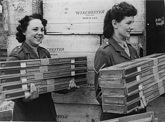 Winchester Repeating Arms Company - British members of the Auxiliary Territorial Service move Winchester firearms during World War II