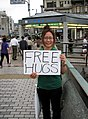 Young lady holding a Free Hugs sign, Kyoto-shi, Kyoto Prefecture, Japan.jpg