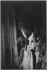 """Stalactite formations in the Queen's Chamber, detail, Carlsbad Caverns National Park,"" New Mexico. (vertical orientatio - NARA - 520042.tif"