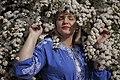 День Вишиванки. Молода україночка у вишитій синій сукні серед квітів 06.jpg