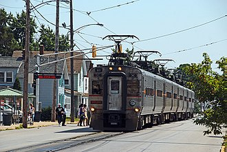 Street running - A NICTD EMU street running on in Michigan City's 11th Street; United States, in 2009.