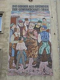 1120 Schönbrunner Straße 191-193 - Wandmosaik Die Gerber als Gründer der Gewerkschaft 1866 IMG 5125.jpg