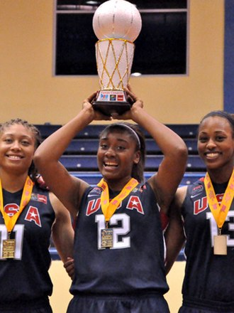United States women's national under-19 basketball team - Morgan Tuck hoists the championship trophy at the award ceremonies in Gurabo, Puerto Rico