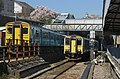 150258 and 150231 pass each other at Pontypridd Station (16511349834).jpg