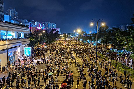 Stand-off between protesters and police near Sha Tin Jockey Club Swimming Pool. Night of 14 July. 190714 HK Protest Incendo 02.jpg