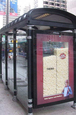Transportation in Chicago - City of Chicago bus stop, served by CTA buses, with 3D ad