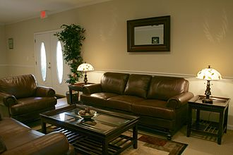Couch - A three-cushion couch in an office lobby