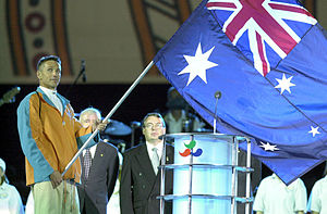 Robert Steadward - Robert Steadward looks on as the Australian flag is brought to the stage by flagbearer Brendan Burkett during the opening ceremony of the 2000 Sydney Paralympic Games.