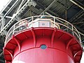 2015 Little Red Lighthouse annual tour (03) Park Ranger on gallery deck playing recorder seen from below.jpg