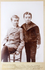 2 boys by Hastings of 146 Tremont Street in Boston.png