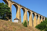 2 typical stone architecture relicts in the Dordogne, stone bridges and so called bouriane (the small storage house at the foot of the bridge) - panoramio.jpg
